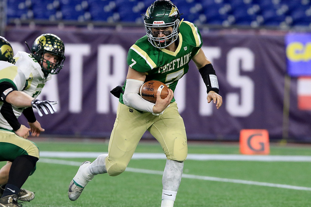 . Nashoba Regional High School\'s Sam Bolinsky takes off with the ball as he ties to by Dighton-Rehoboth Regional High School players during their Superbowl game at Gillette Stadium in Foxborough on Friday night, November 30, 2018. SENTINEL & ENTERPRISE/JOHN LOVE