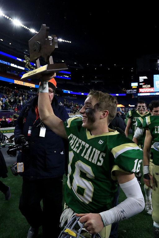 . Nashoba Regional High School player Will Danby holds up the Superbowl trophy after their win over Dighton-Rehoboth Regional High School at Gillette Stadium in Foxborough on Friday night, November 30, 2018. SENTINEL & ENTERPRISE/JOHN LOVE