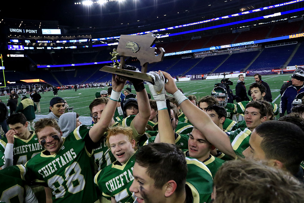 . Nashoba Regional High School football team holds up the superbowl trophy after their win over Dighton-Rehoboth Regional High School at Gillette Stadium in Foxborough on Friday night, November 30, 2018. Nashoba won, 31-0. SENTINEL & ENTERPRISE/JOHN LOVE