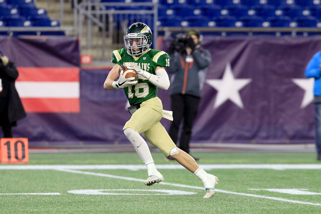 . Nashoba Regional High School\'s Will Danby makes a catch  and runs for a touchdown during their win over Dighton-Rehoboth Regional High School at Gillette Stadium in Foxborough on Friday night, November 30, 2018. SENTINEL & ENTERPRISE/JOHN LOVE