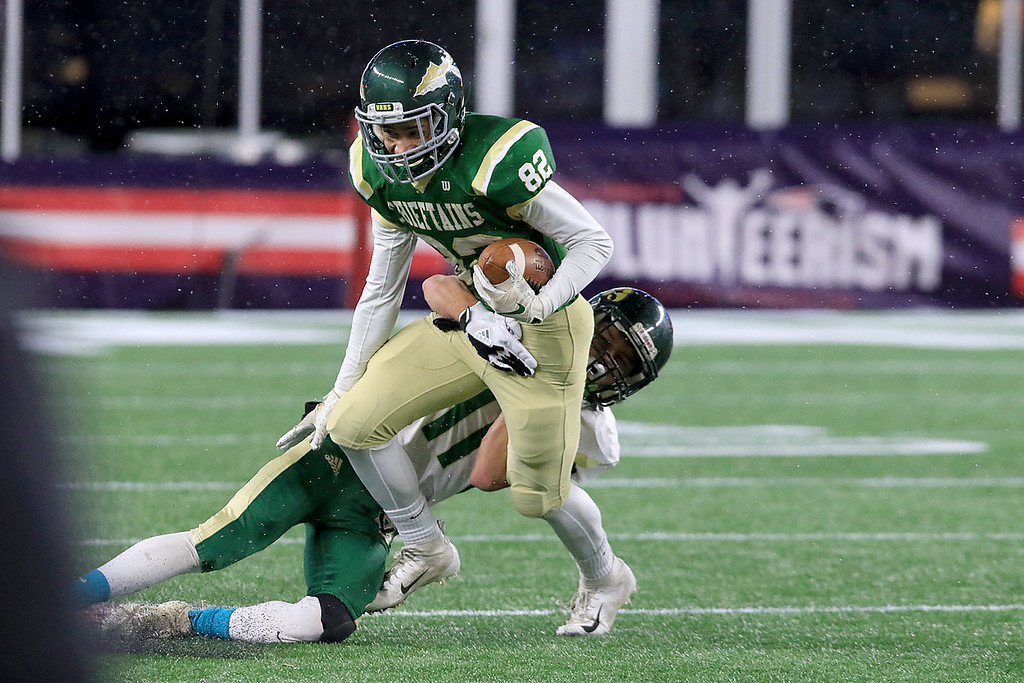 . Nashoba Regional High School\'s John Foney is tackled by Dighton-Rehoboth Regional High School\'s Owen Arden during their Superbowl game at Gillette Stadium in Foxborough on Friday night, November 30, 2018. SENTINEL & ENTERPRISE/JOHN LOVEJoh
