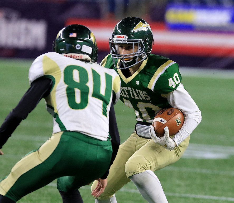 . Nashoba Regional High School\'s Danny McNulty tries to get around Dighton-Rehoboth Regional High School\'s Blake Kerwin during the Superbowl game at Gillette Stadium in Foxborough on Friday night, November 30, 2018. SENTINEL & ENTERPRISE/JOHN LOVE