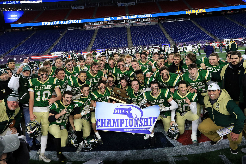 . Nashoba Regional High School pose for a picture with the Superbowl trophy after their win over Dighton-Rehoboth Regional High School at Gillette Stadium in Foxborough on Friday night, November 30, 2018. SENTINEL & ENTERPRISE/JOHN LOVE