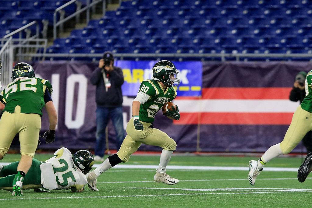 . Nashoba Regional High School\'s Brendan Lee finds some running room as he gets by Dighton-Rehoboth Regional High School Joseph Carrera during their Superbowl game at Gillette Stadium in Foxborough on Friday night, November 30, 2018. SENTINEL & ENTERPRISE/JOHN LOVE