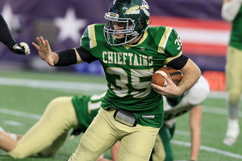 . Nashoba Regional High School\'s Alex Childs tries to find some running room during their win over Dighton-Rehoboth Regional High School at Gillette Stadium in Foxborough on Friday night, November 30, 2018. SENTINEL & ENTERPRISE/JOHN LOVE