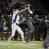 Monty Tech senior Kirby Martin (left) pulls Nashoba senior Steven Buturlia (right) from the ball for an incomplete pass during the Thanksgiving Eve game on Wednesday November 23, 2016 between Nashoba Tech and Monty Tech at Nashoba.  (Sentinel & Enterptrise photo/Jeff Porter)