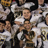 Monty Tech football players with the Thanksgiving Trophy after the Thanksgiving Eve game on Wednesday November 23, 2016 between Nashoba Tech and Monty Tech at Nashoba.  (Sentinel & Enterptrise photo/Jeff Porter)