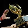 The Thanksgiving trophy passed among Monty Tech teammates after the Thanksgiving Eve game on Wednesday November 23, 2016 between Nashoba Tech and Monty Tech at Nashoba.  (Sentinel & Enterptrise photo/Jeff Porter)