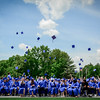 Nashoba Valley Tech Grads throw up their caps at the end of their graduation ceremony. SUN/Caley McGuane