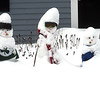 This family of snow-people outside a home on Chicopee Row in Groton would make a great Christmas card.NVV/ David H. Brow