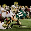 Nashoba's Nate Mansour is brought down by the Doherty defense during the Central Mass. Division 2A semifinal on Friday evening. SENTINEL & ENTERPRISE / Ashley Green
