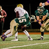 Nashoba's Breese Hill brings down the Doherty ball carrier during the Central Mass. Division 2A semifinal on Friday evening. SENTINEL & ENTERPRISE / Ashley Green