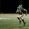 Nashoba's Nate Mansour runs the ball during the Central Mass. Division 2A semifinal against Doherty on Friday evening. SENTINEL & ENTERPRISE / Ashley Green