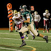 Nashoba's Nate Mansour breaks away from the pack to run it in for a touchdown during the Central Mass. Division 2A semifinal against Doherty on Friday evening. SENTINEL & ENTERPRISE / Ashley Green