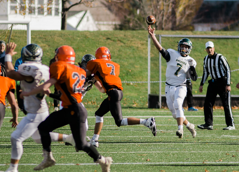 Nashoba's Sam Bolinsky competes a pass during the Central Mass. Division 2A title game against Marlboro on Saturday afternoon. Nashoba was defeated 42-21. SENTINEL & ENTERPRISE / Ashley Green