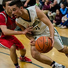 Nashoba's Nate Mansour in action during the Central Mass. Division 2 quarterfinal game against Milford on Thursday, March 2, 2017. SENTINEL & ENTERPRISE / Ashley Green