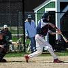 North Middlesex's David Hurley connects with a pitch during the game against Nashoba on Tuesday, April 18, 2017. SENTINEL & ENTERPRISE / Ashley Green