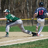Nashoba's Connor Ojerholm tags North Middlesex's Nick White out during the game on Tuesday, April 18, 2017. SENTINEL & ENTERPRISE / Ashley Green