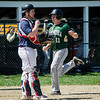 Nashoba's Luke Danby scores a run during the game against North Middlesex on Tuesday, April 18, 2017. SENTINEL & ENTERPRISE / Ashley Green