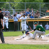 Nashoba's Cam Roberts attempts the tag at home plate
