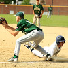 Nashoba's Luke Worthington attempts the catch to tag out a Shrewsbury player