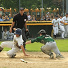 Catcher Nick Machado tries to tag out Casey Boudreau but isnt sucessfull