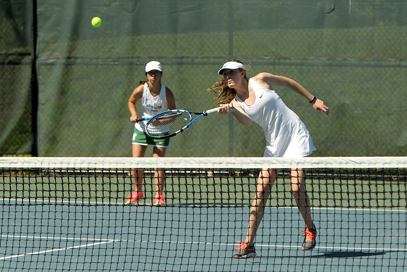 Photo Scott LaPrade - Nashoba Regional's Kaylin Castles hits while her partner, Leah Farinella, looks on during their doubles match as Nashoba faced Wachusett in the Central Mass. Division 1 semifinals in Bolton on Wednesday, June 7, 2017.