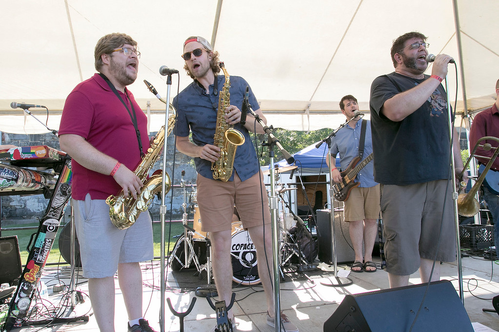 ". The 2019 Nashua River Brewers Festival held at Riverfront Park in Fitchburg Saturday, June 29, 2019. the festival was put on by ""Beers for Good\"" and the City of Fitchburg. Entertaining the crowd as they performed with the group \""The Copacetics\"" is from left Stephen Grueb, Nick Zambrotta and Matt Di Chiara. SENTINEL & ENTERPRISE/JOHN LOVE"