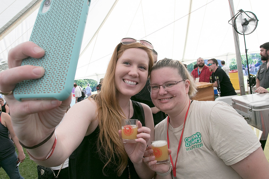". The 2019 Nashua River Brewers Festival held at Riverfront Park in Fitchburg Saturday, June 29, 2019. the festival was put on by ""Beers for Good\"" and the City of Fitchburg. Taking a selfie at the festival is Anne Marie Wolff of Shirley and Cherie Borey of Fitchburg. SENTINEL & ENTERPRISE/JOHN LOVE"