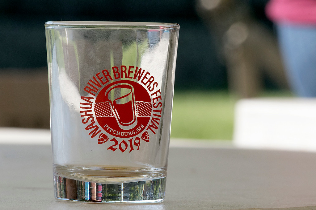 ". The 2019 Nashua River Brewers Festival held at Riverfront Park in Fitchburg Saturday, June 29, 2019. the festival was put on by ""Beers for Good\"" and the City of Fitchburg. This is the sample glass you got to try all of the beers. This one had already seen a lot of beer. SENTINEL & ENTERPRISE/JOHN LOVE"