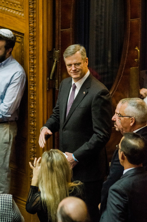 . Gov. Charlie Baker enters the house chamber as the Massachusetts House of Representatives gathered for the 190th general court and swearing-in ceremony on Wednesday morning at the State House in Boston. SENTINEL & ENTERPRISE / Ashley Green