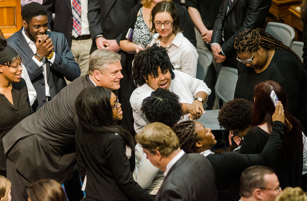 . Gov. Charlie Baker snaps a selfie with members of the UMASS Lowell Gospel Choir as the Massachusetts House of Representatives gathered for the 190th general court and swearing-in ceremony on Wednesday morning at the State House in Boston. SENTINEL & ENTERPRISE / Ashley Green