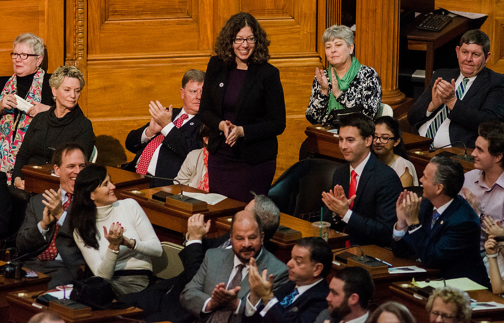 . Newly appointed Leominster State Representative Natalie Higgins is congratulated by her peers after being sworn-in at the Massachusetts State House on Wednesday morning. SENTINEL & ENTERPRISE / Ashley Green