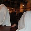 Nate and Grandpa playing peek a boo at Red Lobster