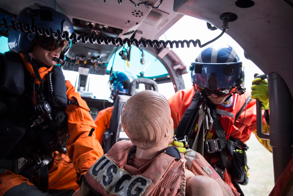 . Rescue swimmer Adam Carr brings in the rescue dummy after the final hoist of the day at Patrick\'s Point on Aug. 2.  (Sam Armanino - Times-Standard)