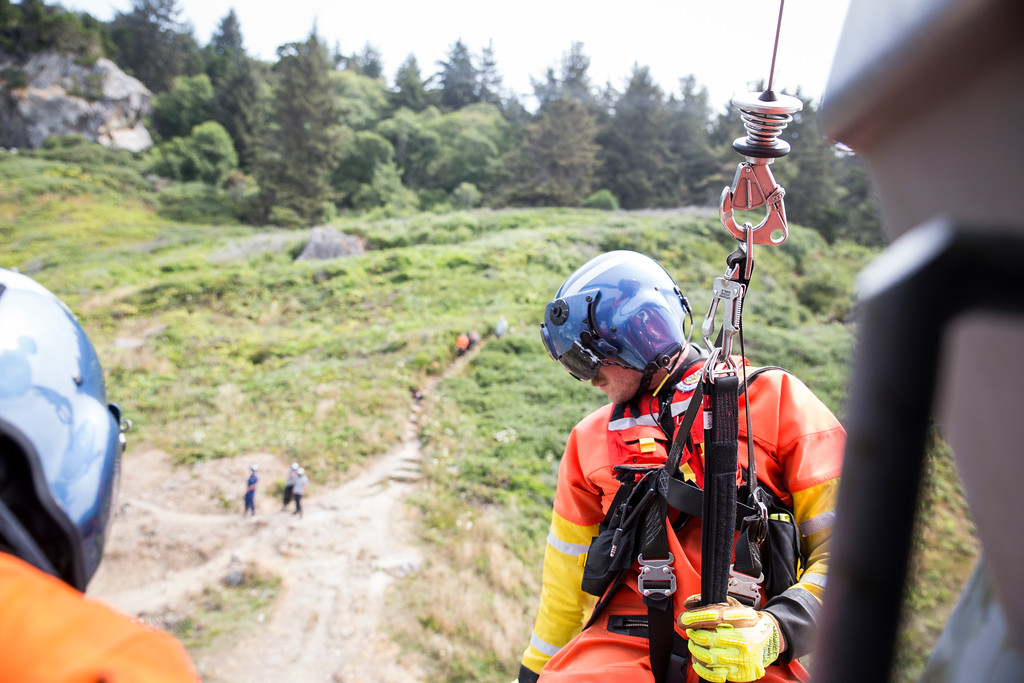 . Rescue swimmer Adam Carr looks down at his landing on his third and final hoist of the day on Aug. 2.  (Sam Armanino - Times-Standard)
