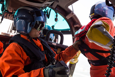 Brent Alexander pulls rescue swimmer Adam Carr into the helicopter after one of three successful training hoists.  (Sam Armanino - Times-Standard)