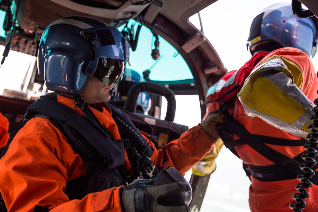 . Brent Alexander pulls rescue swimmer Adam Carr into the helicopter after one of three successful training hoists.  (Sam Armanino - Times-Standard)