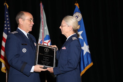Lt. Col. Christine Lee receiving the 50 Years of Outstanding Service To Civil Air Patrol Award.  Photo by Susan Schneider, CAPNHQ