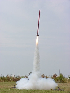 A rocket lifts off from the NARAM-47 sport range.  Photo by Greg Smith.