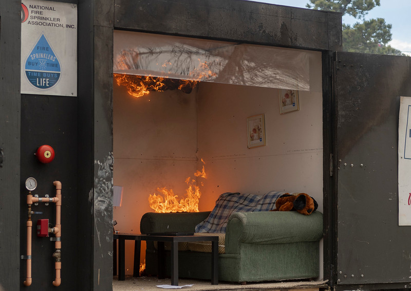 A fire burns in a side-by-side trailer where there are no fire sprinklers equipped. The fire burned for several minutes before being put out.