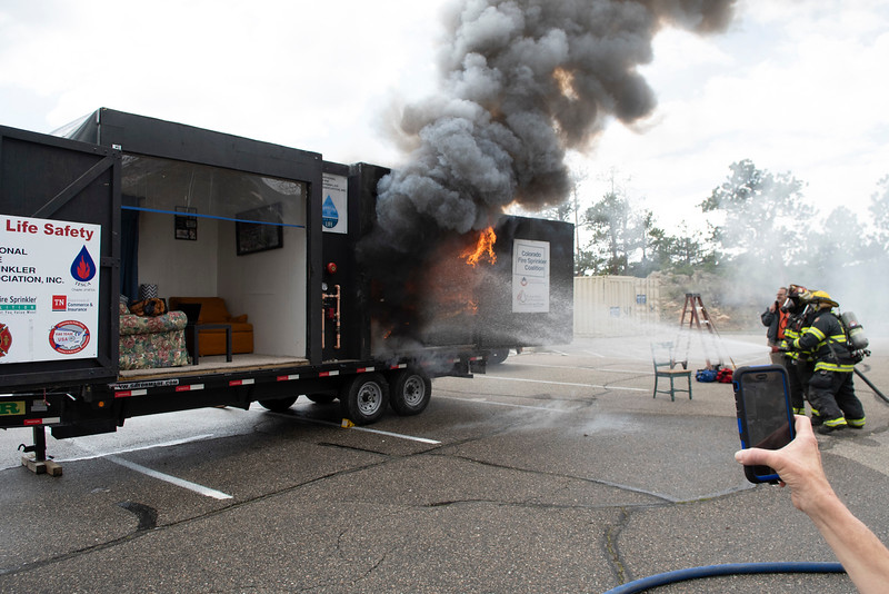 The first of two fire demonstrations is quickly put out by Estes Valley Firefighters.