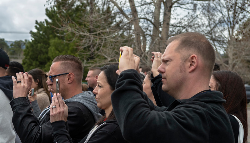 Viewers take photos of a live fire demonstration put on by the National Fire Sprinkler Association on April 24.