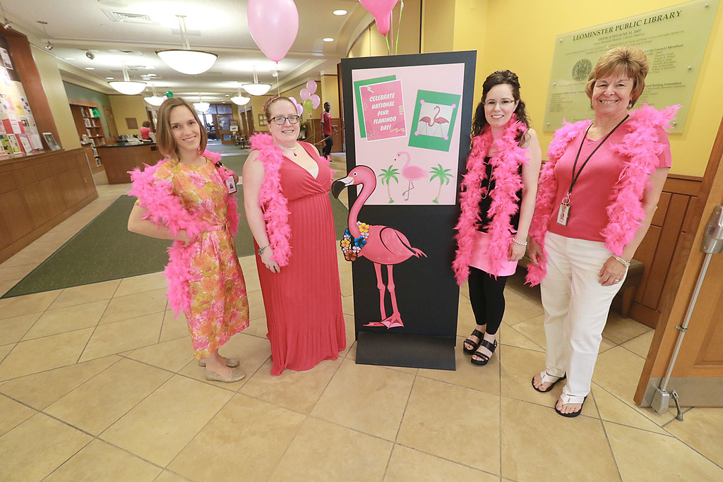 . The Leominster public Library held a celebration of National Pink Flamingo Day on Friday afternoon. The staff got in the spirit of the day by dressin up in a lot of pink. From left is  Director Sondra Murphy, Circulation Assistant Nicloe Piermarini, Head of Childrens Services Sarah Chapdelaine and Head of Circulation Nancy Tourigny. SENTINEL & ENTERPRISE/JOHN LOVE