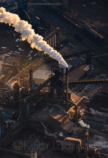 Aerials over heavy industrial shoreline over southern chicago and north east Indiana