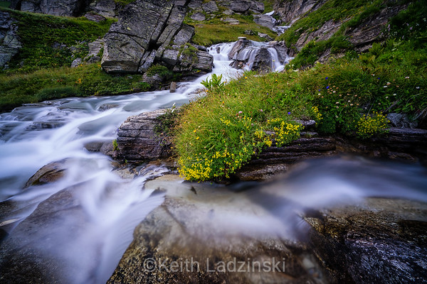 A mountain stream cascading down into the beautiful and colorful Bonneval-sur-Arc valley in the French Alps.