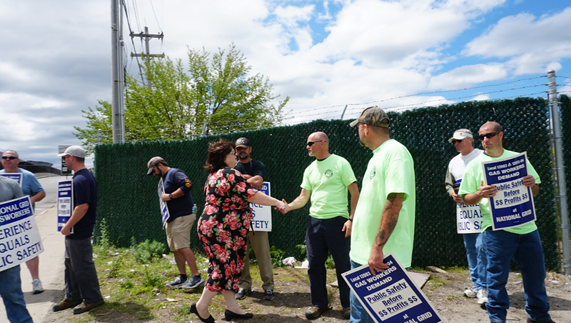 . State Rep. Colleen Garry shakes the hand of Mike Masse of Plaistow NH. who has worked at National Grid for 28 years. (The Sun / Chris Tierney)