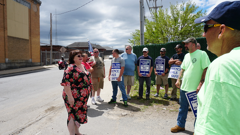 . State Rep. Colleen Garry talks with National Grid employees from United Steel Workers USW12012-04 Unioun who are blocking the gate on School street.  (The Sun / Chris Tierney) (The Sun / Chris Tierney)