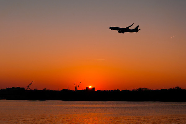 Jet at sunset over the Tidal Basin, Washington, DC
