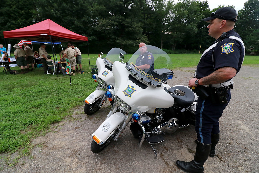 ". ""National Night Out\"" was held at Lowe Playground in Fitchburg on Tuesday night. Officers Fred Lake, on bike, and Mike Fancher wait for kids to come over and see them during the event. SENTINEL& ENTERPRISE/JOHN LOVE"